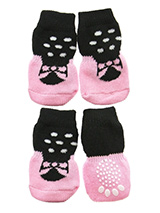 Ballerina Pet Socks - These fun and functional doggie socks protect your dogs paws from mud, snow, ice, hot pavement, hot sand and other extreme weather. Made from 95% cotton & 5% spandex making them comfortable and secure. Each sock features a paw shaped anti-slip silica pad & help keep your house sanitary. (set of 4).