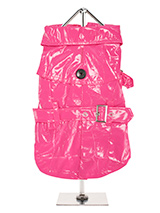 Fuschia Waterproof Trench Coat  - This iconic high gloss trench coat is a key piece for any winter wardrobe and represents an exciting twist on this classic wardrobe staple. It is 100% waterproof with a leash hole to allow a harness to be worn underneath the coat. This sophisticated yet practical trench coat has a fully adjustable b...